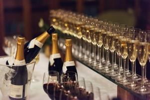 Champagne bottles and glasses during Miele event management
